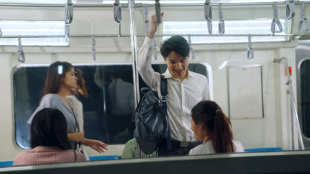 Crowd of people on a busy crowded public subway train travel . Commuting and urban lifestyle concept .