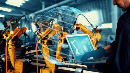 Smart industry robot arms modernization for digital factory technology . Concept of automation manufacturing process of Industry 4.0 or 4th industrial revolution and IOT software control operation .