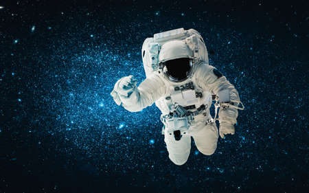 Astronaut spaceman do spacewalk while working for space station in outer space . Astronaut wear full spacesuit for space operation .