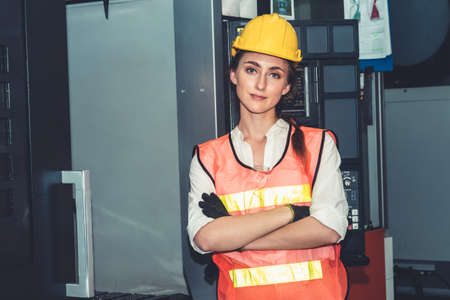 Young woman factory worker close up portrait in manufacturing job factory . Industry and engineering concept .