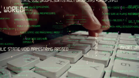Creative visual of computer programming coding and software development shown by man working on computer keyboard with overlay of computer graphic displaying abstract program codes and computer script