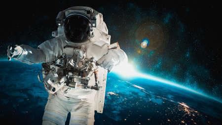 Astronaut spaceman do spacewalk while working for space station in outer space . Astronaut wear full spacesuit for space operation Zdjęcie Seryjne