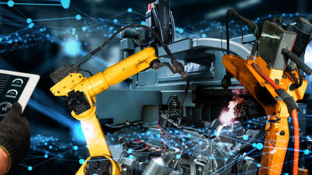 Smart industry robot arms modernization for innovative factory technology . Concept of automation manufacturing process of Industry 4.0 or 4th industrial revolution and IOT software control operation.