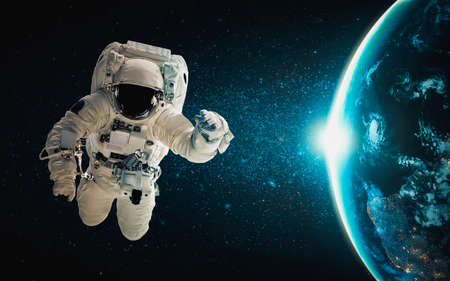Astronaut spaceman do spacewalk while working for space station in outer space . Astronaut wear full spacesuit for space operation