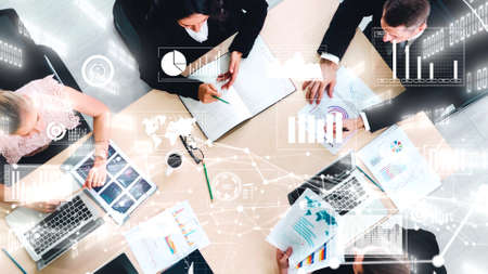 Creative visual of business people in corporate staff meeting . Concept of digital technology for marketing data analysis and investment decision making .