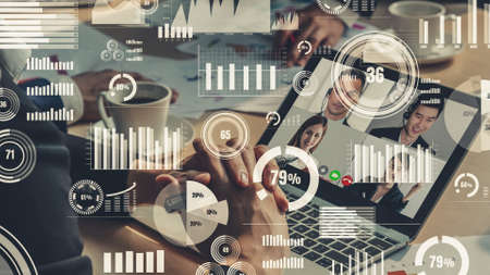 Creative visual of business people in a corporate staff meeting on video call . Concept of digital technology for marketing data analysis and investment decision making .