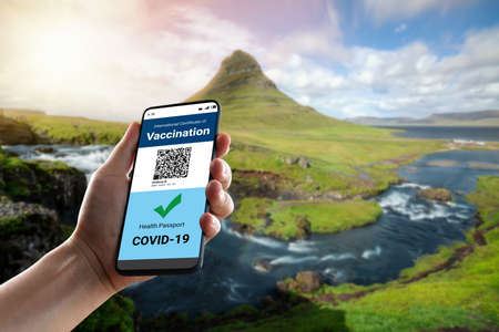 Traveler holds vaccine passport certificate to show COVID 19 vaccination status . The digital health certificate is required for international travel during coronavirus pandemic . Reklamní fotografie