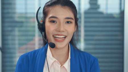 Video call camera view of businesswoman talks actively in videoconference . Call center, telemarketing, customer support agent provide service on telephone video conference call.