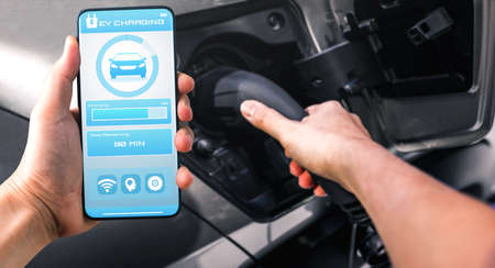 EV charging station for electric car with mobile app display charger status . The electric power is produced from sustainable resources to supply to charger station in order to reduce CO2 emission .
