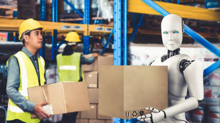 Innovative industry robot working in warehouse together with human worker . Concept of artificial intelligence for industrial revolution and automation manufacturing process . 免版税图像