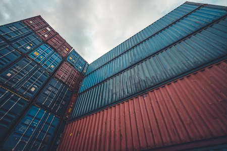 Cargo container for overseas shipping on high stack look up from ground . Logistics supply chain management and international goods export concept . 免版税图像