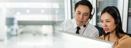 Business team wearing headset working actively in office . Call center, telemarketing, customer support agent provide service on telephone video conference call. 免版税图像