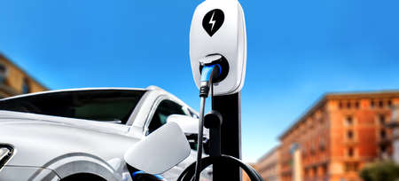 EV charging station for electric car in concept of green energy and eco power produced from sustainable source to supply to charger station in order to reduce CO2 emission . 免版税图像