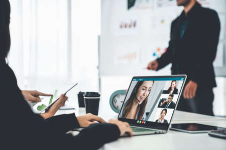 Business people in video call meeting proficiently discuss business plan in office and virual workplace . Telework conference call using smart video technology to communicate colleague .