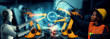 Mechanized industry robot and human worker working together in future factory . Concept of artificial intelligence for industrial revolution and automation manufacturing process .