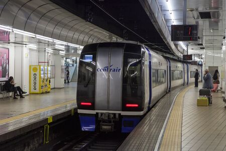 treno espresso: Nagoya,Japan - April 1,2015 : The Meitetsu -SKY Limited Express train airport express train from Central Japan International Airport at Nagoya station. Editoriali