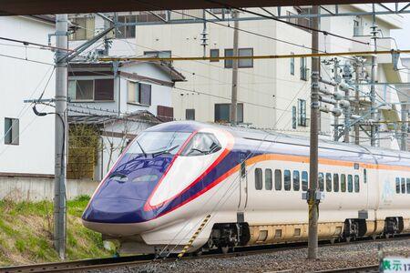YAMAGATA,JAPAN - APRIL 14,2016: E3 Series bullet (High-speed) train at Yamagata station. This is new color, enter service in April 2014 for Yamagata Shinkansen line.(Tokyo - Yamagata or Shinjo route)