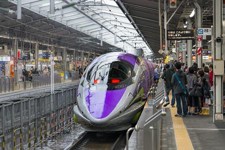 sanyo: OSAKA,JAPAN-APRIL 7,2016:500 TYPE EVA, the spaceship-themed Shinkansen. This is special Shinkansen train to celebrate 40th anniversary of Sanyo Shinkansen and 20th anniversary of Evangelion TV series.