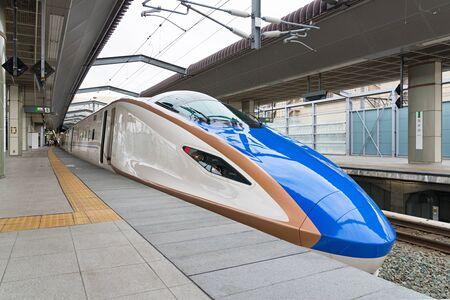 intercity: NAGANO,JAPAN-APRIL 8,2016:E7 Series bullet (High-speed or Shinkansen) train.This train operated by JR East and JR West,services as Kagayaki(Shine) for Hokuriku Shinkansen line(Tokyo - Kanazawa route).