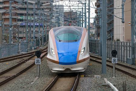 hokuriku: NAGANO,JAPAN-APRIL 8,2016:E7 Series bullet (High-speed or Shinkansen) train.This train operated by JR East and JR West,services as Kagayaki(Shine) for Hokuriku Shinkansen line(Tokyo - Kanazawa route).