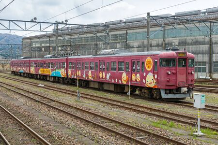 operated: ISHIKAWA,JAPAN - APRIL 8,2016 : The local train at Nanao station. The train livery is Wakutamakun (Wakura hot spring mascot),This train operated by JR West in Kanazawa-Wakura onsen route. Editorial