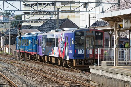 ISHIKAWA,JAPAN - APRIL 8,2016 : The NO TO GO! train. The robot Mazinger Z on train livery by manga artist Kiyoshi Nagai, pen-name Go Nagai, who born in Ishikawa. This train operated by Noto Railway. Editorial
