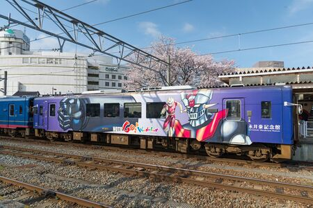 operated: ISHIKAWA,JAPAN - APRIL 8,2016 : The NO TO GO! train. The robot Mazinger Z on train livery by manga artist Kiyoshi Nagai, pen-name Go Nagai, who born in Ishikawa. This train operated by Noto Railway. Editorial