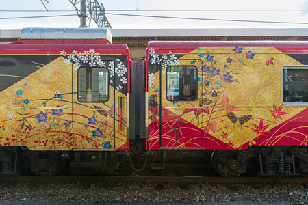 ryokan: ISHIKAWA,JAPAN-APRIL 8,2016:The exterior of sightseeing train Hanayome Noren (Brides curtain  good luck charm). Train livery inspired by local traditional arts, such as lacquer ware, silk-dyeing.