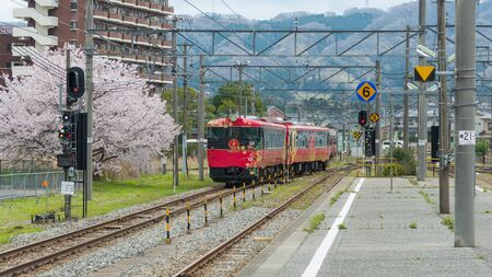 good luck charm: ISHIKAWA,JAPAN-APRIL 8,2016:The sightseeing train Hanayome Noren (Brides good luck charm). Train livery inspired by local traditional arts, such as lacquer ware, silk-dyeing. operated by JR West. Editorial