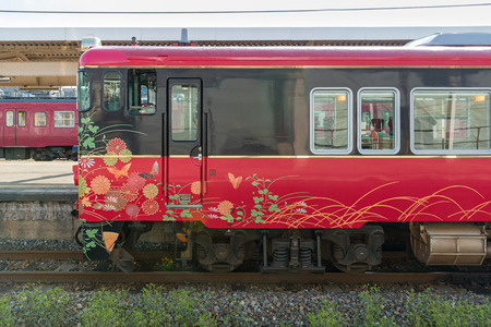good luck charm: ISHIKAWA,JAPAN-APRIL 8,2016:The exterior of sightseeing train Hanayome Noren (Brides curtain  good luck charm). Train livery inspired by local traditional arts, such as lacquer ware, silk-dyeing.