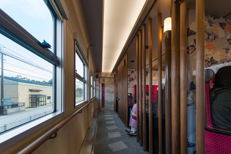ishikawa: ISHIKAWA,JAPAN - APRIL 8,2016 : Interior of sightseeing train Hanayome Noren. This 1st  car have 8 semi-private rooms. The aisle carpets designed to represent steppingstones in Japanese gardens.