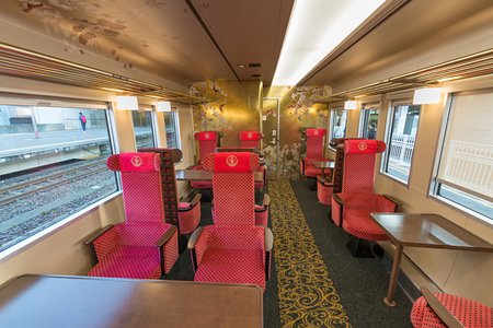 lacquer ware: ISHIKAWA,JAPAN-APRIL 8,2016:Interior of the Hanayome Noren train. The 2nd car adopt designs often used in local lacquer-ware. Doors and ceiling detailing like gold leaf and cherry blossom pattern.