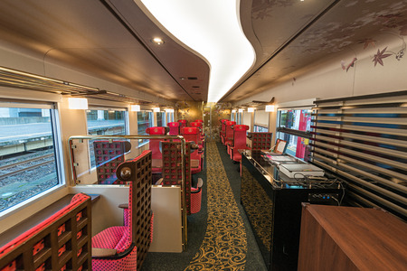 lacquerware: ISHIKAWA,JAPAN-APRIL 8,2016:Interior of the Hanayome Noren train. The 2nd car adopt designs often used in local lacquer-ware. Doors and ceiling detailing like gold leaf and cherry blossom pattern.