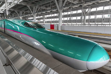 HOKKAIDO,JAPAN-APRIL 19,2016: The green E5 Series bullet(High-speed) trains in Shin-Hakodate-Hokuto station.It service as Hayabusa(Falcon) or Hayate operated by JR EastHokkaido for TohokuHokkaido Shinkansen lines.