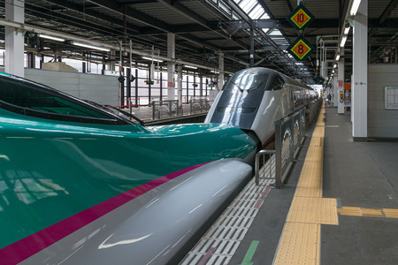 coupled: IWATE,JAPAN-April 19,2016:The E5(Green)E3(White) High-speed trains combination at Morioka station. They coupled together from Tokyo to Morioka. Both trains operated by JR East. Editorial
