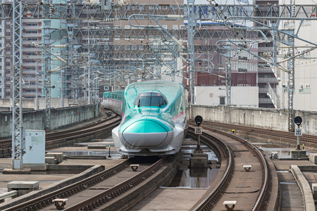 TOKYO-April 14,2016:The green E5 Series bullet (High-speed) train. It services as Hayabusa(Falcon) or Hayate operated by JR East and JR Hokkaido for Tohoku and Hokkaido Shinkansen.(Tokyo - Hakodate).