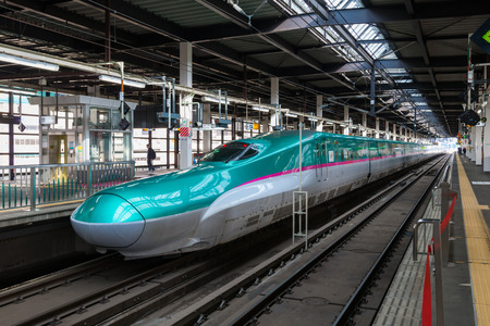 "IWATE,JAPAN-April 19,2016:The green E5 Series bullet(High-speed) train in Morioka station.It service as ""Hayabusa(Falcon) or Hayate"" operated by JR East/Hokkaido for Tohoku/Hokkaido Shinkansen lines."