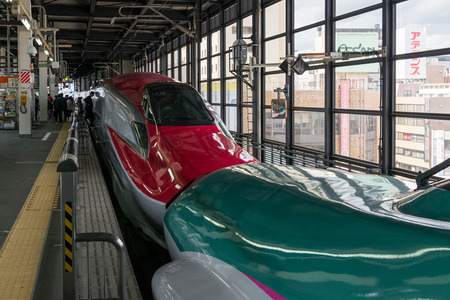 coupled: IWATE,JAPAN-April 19,2016:The E5(Green)E6(Red) High-speed trains combination at Morioka station. They coupled together from Tokyo to Morioka. After Morioka,E5 go to Aomori and E6 go to Akita.