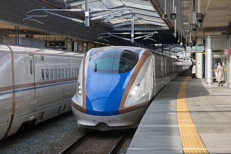 hokuriku: NAGANO,JAPAN-APRIL 9,2016: E7 Series bullet (High-speed or Shinkansen) train. This train services as Kagayaki(Shine) for Hokuriku Shinkansen line(Tokyo - Kanazawa route).