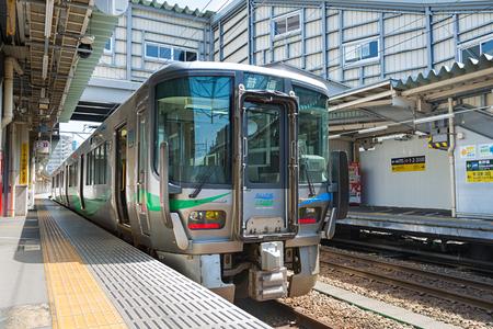 TOYAMA,JAPAN-APRIL 9,2016: Local train at Toyama station. This train use 521 Series train, operated by a Japanese third-sector railway Ainokaze Toyama railway company for Kurikara - Ichiburi route.