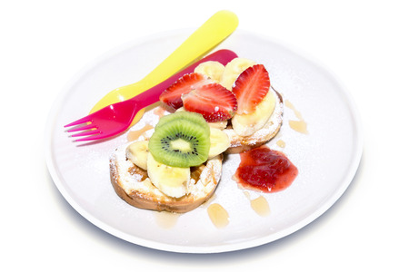 Top Sprinkle fruit on bread with strawberry jam on white background photo