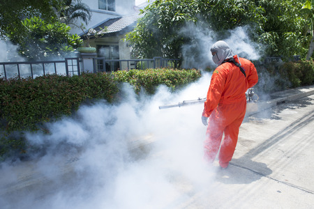 malaria: Workers are fogging for dengue control. Stock Photo
