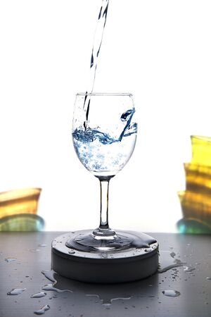 Water is poured into a glass