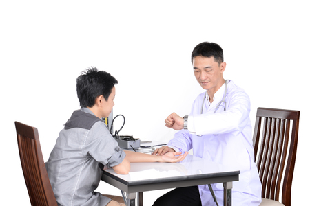 nurse station: Doctor checking the pulse patient in the examination room.