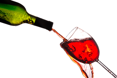 glass of red wine: Red wine being poured into a wine glass.