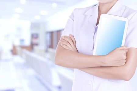 patient data: Nurses monitor patient data using tablet. Stock Photo