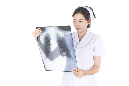 patient data: Nurse examine patient data from medical x-ray film. Stock Photo