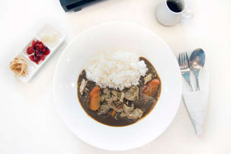 side dishes: Japanese curry rice with pork, and side dishes. Stock Photo