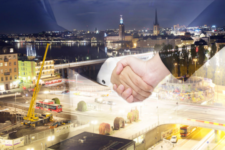 converge: Teamwork for success of the business in the future. Double Exposure of handshake. Stock Photo