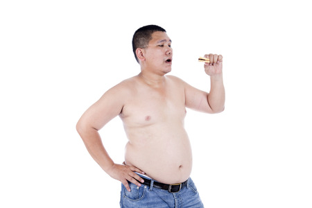 pinching: Belly fat people at large from eating behaviors. Junk food. Enjoy eating